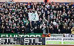S&ouml;dert&auml;lje 2014-04-07 Fotboll Superettan Assyriska FF - Hammarby IF :  <br /> Hammarby supportrar med en flagga med ett portr&auml;tt av Kennedy Bakircioglu <br /> (Foto: Kenta J&ouml;nsson) Nyckelord:  Assyriska AFF S&ouml;dert&auml;lje Hammarby HIF Bajen supporter fans publik supporters