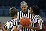 14 November 2012: Referee Daryl Humphrey confers with Karen Gruca (left) and Fatou Cissoko (right). The University of North Carolina Tar Heels played the Georgetown University Hoyas at Carmichael Arena in Chapel Hill, North Carolina in an NCAA Division I Women's Basketball game, and a semifinal in the Preseason WNIT. UNC won the game 63-48.