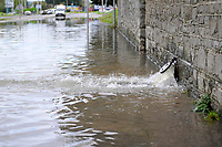 Pictured: Water bursts out of a pipe in the flood caused by Storm Callum, in Carmathen, Wales, UK. Sunday 14 October 2018<br /> Re: The aftermath of the flood caused by the unusually high tide of rover Towy and storm Callum in Carmarthen west Wales, UK.