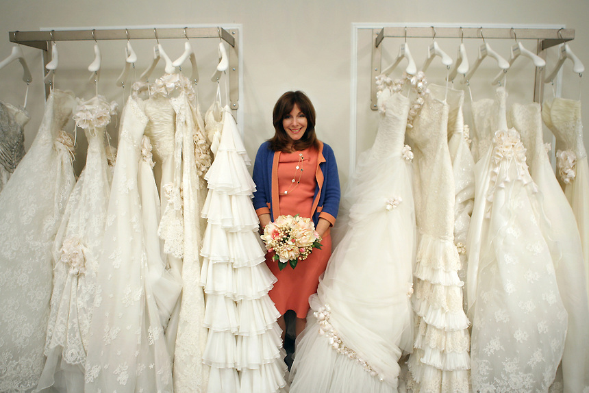 """Wedding planner Mindy Weiss, author of """"The Wedding Book"""" poses amid wedding gowns at Kleinfeld's.  110 W. 20 St., NYC.  Newsday/Ari Mintz  4/15/2008."""