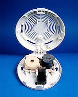 IONIZING SMOKE DETECTOR<br /> Radioactive Source Ionizes Charged Air Particles<br /> A radioactive source ionizes charged air particles between two electrodes. When smoke particles enter the chamber they attract the ions and reduce the current. A microchip responds to the reduced current by activating an alarm.