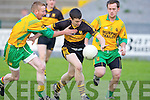 Jamie Doolan Dr Crokes goes past Timmy O'Leary and Danny O'Connor Gneeveguilla in their Castleisland Mart club Championship game in Killarney on Saturday night