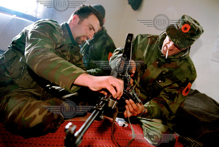 KLA soldiers check theri weapons after fighting in Lapashtica, North East Kosovo.21/02/99.