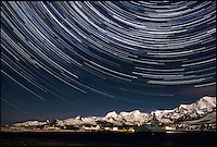 BNPS.co.uk (01202 558833).Pic: SamanthaCrimmin/BNPS..***Please Use Full Byline***..Star trails above HMS Clyde at King Edward Point in South Georgia...A British Doctors braved freezing conditions to capture unique pictures of the night sky from the tiny British island of South Georgia in the remote South Atlantic...Amateur photographer Samantha Crimmin's stunning photos of the sky at night over South Georgia have left locals so star-struck they have been turned into stamps...Dr Samantha Crimmin was working as an emergency medic for the British Antartic Survey team when she took the celestial images in her spare time...Dr Crimmin used long exposures and plenty of patience to create the incredible shots that show star trails in a perfect circular motion...Her gallery of photos depict the night sky above different locations on the tiny outpost in the south Atlantic...They include one above the Harker Glacier - named after British geologist Alfred Harker - and over the wrecks of two Norwegian whaling ships at Grytviken.