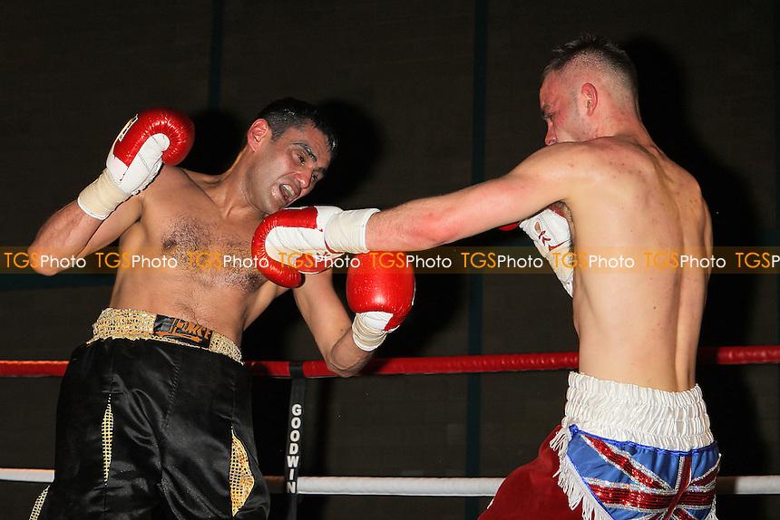 Michael Devine (claret shorts) defeats Sid Razak in a Lightweight boxing contest at Goresbrook Leisure Centre,Dagenham, promoted by Steve Goodwin - 19/03/11 - MANDATORY CREDIT: Gavin Ellis/TGSPHOTO - Self billing applies where appropriate - Tel: 0845 094 6026