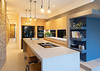 BNPS.co.uk (01202 558833)<br /> Pic: SelenckyParsons/BNPS<br /> <br /> The 'tardis' like interior is spread across three floors..<br /> <br /> Slight Move? - Gap in the market has been filled by this deceptive 'tardis' like new London home.<br /> <br /> The unique 'infill' house which is just 11ft wide has emerged on the market for £1.25million.<br /> <br /> The Coach House has been cleverly designed in an L shape to fit perfectly in the narrow gap between two Victorian houses.<br /> <br /> The three storey, four bedroom property in New Cross, South London, widens out at the end and opens up onto its garden.<br /> <br /> The home, which is on the site of a former coach house, has been designed by architects Selencky and Parsons.