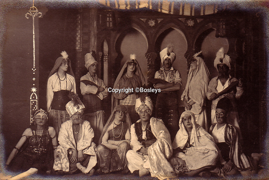 BNPS.co.uk (01202 558833)<br /> Pic: Bosleys/BNPS<br /> <br /> An Arab themed play including belly dancer (bottom left) - A regular series of amateur dramatic shows were put on in the camp. <br /> <br /> The stark contrast between the relative life of luxury enjoyed by captured Tommies of the First World War to the hell of the trenches they left behind can be revealed in a remarkable archive.<br /> <br /> It seems that being taken prisoner was a blessing in disguise judging by the gallery of photos that show the British officers leading a very civilised life at a German PoW camp.<br /> <br /> There was a gentlemen's agreement in place which would see the detainees allowed outside the camp during the day as long as they returned by the evening.<br /> <br /> The archive of Lieutenant Charles Mayo, which includes three of his First World War medals, is being sold by Bosley's auctioneers of Marlow, Bucks on Wednesday.