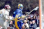 Los Angeles, CA 04/11/09 -  Ryan Sanders (UCSB#5) presses forward towards the LMU goal as Travis Abraham (LMU #10) defends him during the UCSB-LMU Men's Lacrosse game played at Loyola Marymount University's Leavey Field.