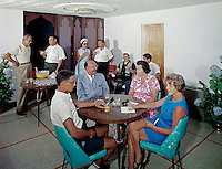 Drinks in the Shalimar Motel lounge. Retro 1960's photograph.