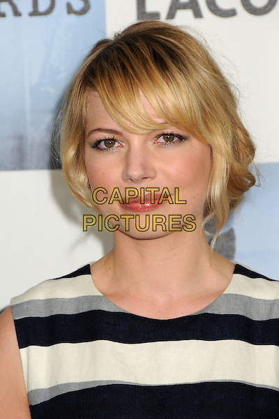MICHELLE WILLIAMS .2009 Film Independent's Spirit Awards - Arrivals held at the Santa Monica Pier, Santa Monica, CA, USA, .21st February 2009..indie independent portrait headshot white black grey gray striped stripes fringe .CAP/ADM/BP.©Byron Purvis/Admedia/Capital PIctures