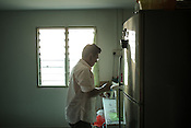 61 year old Lay Kee Tee, a former pig farmer and a  survivor of the Nipah virus prepares a cup of coffee in his house in Bukit Pelandok in Nageri Sembilan, Malaysia on October 16th, 2016. <br /> In September 1998, a virus among pig farmers (associated with a high mortality rate) was first reported in the state of Perak in Malaysia. Dr. Chua investigated and discovered the virus and it was later named, Nipah Virus. The outbreak in Malaysia was controlled through the culling of &gt;1 million pigs.