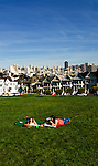 California, San Francisco: Friends talking at Alamo Square in front of Victorians, with the downtown skyline in the background..Photo #: 20-casanf77557.Photo © Lee Foster 2008
