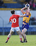 Derek Maguire of Louth  in action against Conor Finucane of Clare during their national League game in Cusack Park. Photograph by John Kelly.