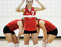 Fauquier's Kathleen Crosby and Nell Davis strategize behind middle blocker Renee Lott (7) during their 3-2 win over Millbrook October 19, 2004 at Fauquier High School in Warrenton, VA.