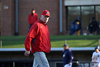 GREENSBORO, NC - FEBRUARY 25: Head coach Bill Currier of Fairfield University returns to the dugout after changing pitchers during a game between Fairfield and UNC Greensboro at UNCG Baseball Stadium on February 25, 2020 in Greensboro, North Carolina.