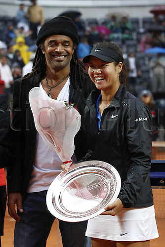 20.05.2012. Rome, Italy  Yannick Noah Presents   Na Li with her runners-up trophy at the Italian Open between Li Na and Maria Sharapova.