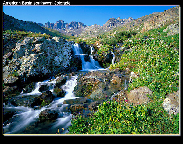 Though it takes a 4WD vehicle to get here, it's an easy valley to photograph. Waterfalls in American Basin, San Juan Mountains.<br /> John offers private, photo tours of Boulder, Denver and Colorado's mountains. .  John leads wildflower photo tours into American Basin and throughout Colorado. All-year long. John guides custom photo tours in the Sneffels Range and throughout Colorado.