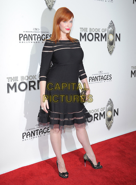 "Christina Hendricks.""The Book of Mormon"" Hollywood Opening night Held At The Pantages theatre, Hollywood, California, USA..September 12th, 2012.full length dress clutch bag tulle black stripe sheer .CAP/DVS.©DVS/Capital Pictures."