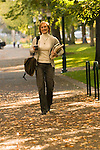 Woman student walking to class with coffee