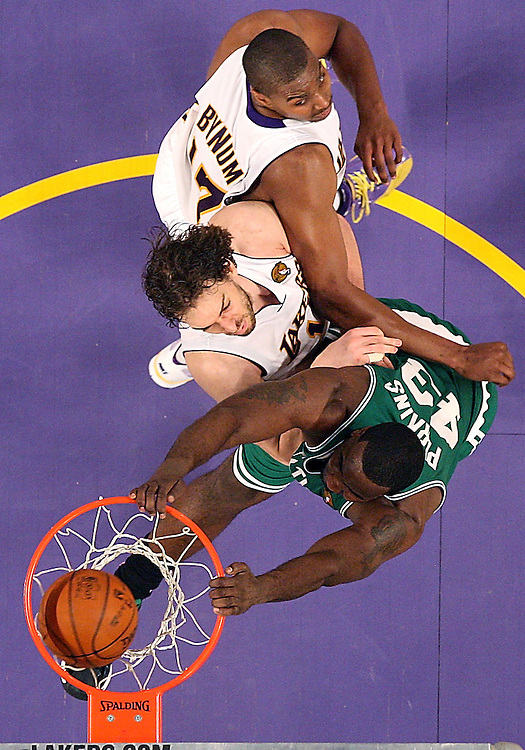 Boston Celtics center Kendrick Perkins dunks the ball past Los Angeles Lakers guard Sasha Vujacic, and Los Angeles Lakers center Andrew Bynum during the second half of game two of the NBA Finals at the Staples Center on Sunday, June 06, 2010.