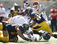California defenders tackle Washington State running back Marcus Mason during the game at Memorial Stadium in Berkeley, California on October 5th, 2013.  Washington State defeated California, 44-22.