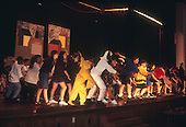 Schenectady, NY.Mont Pleasant Middle School.Middle School students sing and dance on stage for school play. Scan from older film; may not be appropriate for highest resolution print publication usage..Scan from slide film, PN30628.©Ellen B. Senisi