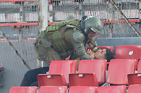 4th February 2020; National Stadium of Chile, Santiago, Chile; Libertadores Cup, Universidade de Chile versus Internacional; A Policeman grapples with a supporter of Universidad de Chile