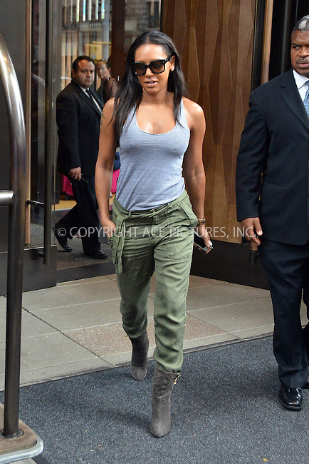 ACEPIXS.COM<br /> <br /> August 12 2014, New York City<br /> <br /> Melanie Brown aka Mel B left a downtown hotel on August 12 2014 in New York City<br /> <br /> By Line: Curtis Means/ACE Pictures<br /> <br /> ACE Pictures, Inc.<br /> www.acepixs.com<br /> Email: info@acepixs.com<br /> Tel: 646 769 0430