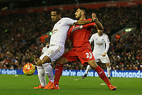 Swansea City's Wayne Routledge  and Liverpool's Emre Can during the Barclays Premier League match between Liverpool and Swansea City played at The Anfield Stadium on November 29th 2015