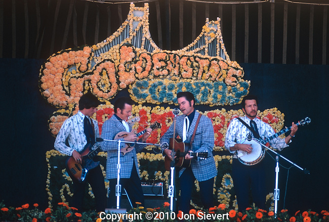 """Jim & Jesse, May 1974, Golden Gate Bluegrass Festival. American bluegrass music duo composed of brothers Jim McReynolds and Jesse McReynolds. Jesse played the mandolin with a unique, self-invented """"crosspicking"""" and """"split-string"""" playing method, and Jim sang as a tenor and played guitar."""