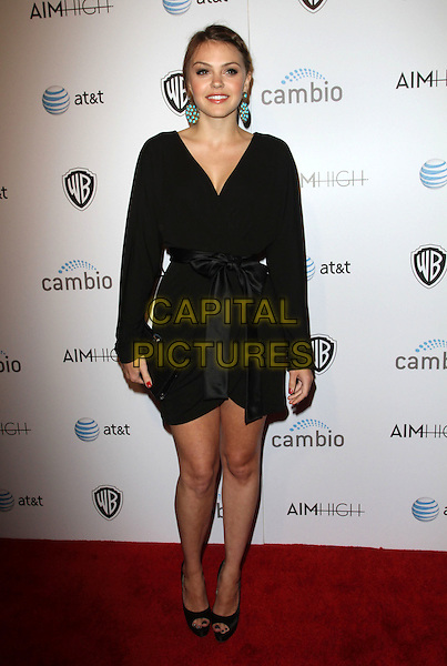 """Aimee Teegarden.""""Aim High"""" Los Angeles Premiere held at Trousdale, West Hollywood, California, USA..October 18th, 2011.full length dress clutch bag wrap ribbon waist black turquoise gold circle disc dangling earrings  .CAP/ADM/KB.©Kevan Brooks/AdMedia/Capital Pictures."""