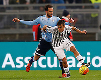 Calcio, Serie A: Lazio vs Juventus. Roma, stadio Olimpico, 4 dicembre 2015.<br /> Juventus&rsquo; Paulo Dybala, right,is challenged by Lazio&rsquo;s Santiago Gentiletti during the Italian Serie A football match between Lazio and Juventus at Rome's Olympic stadium, 4 December 2015.<br /> UPDATE IMAGES PRESS/Riccardo De Luca