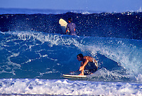 Surfer surfing the pipeline at the North shore of Oahu