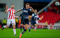 11th January 2020; Bet365 Stadium, Stoke, Staffordshire, England; English Championship Football, Stoke City versus Milwall FC; Shaun Hutchinson of Millwall clears the ball - Strictly Editorial Use Only. No use with unauthorized audio, video, data, fixture lists, club/league logos or 'live' services. Online in-match use limited to 120 images, no video emulation. No use in betting, games or single club/league/player publications