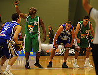 Hugh Quinlivan prepares to shoot a penalty as Kantrail Horton (2nd left), Nick Horvath and Ben Valentine wait for a rebound during the NBL Round 14 match between the Manawatu Jets  and Wellington Saints. Arena Manawatu, Palmerston North, New Zealand on Saturday 31 May 2008. Photo: Dave Lintott / lintottphoto.co.nz