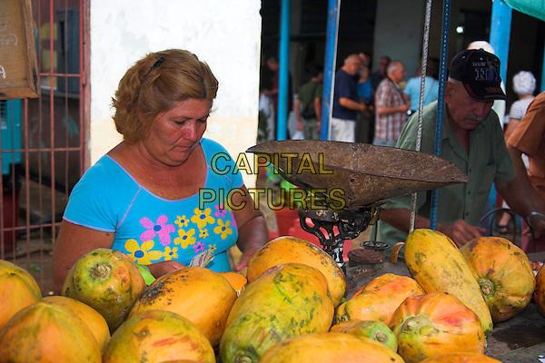 Stallholder selling papayas, street market stall, Sancti Spiritus, Sancti Spiritus Province, Cuba