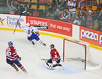 April 28, 2007; Hamilton, ON, CAN; Hamilton Bulldogs centre (84) Corey Locke scores on Rochester Americans goalie (30) Craig Anderson during the third period in game six of the AHL north division semifinal at Copps Coliseum. The Bulldogs won 6-2 and eliminated the Americans from the playoffs. Mandatory Credit: Ron Scheffler, Special to the Spectator. (File number RRSB7076).