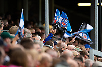 Bath Rugby fans in the crowd wave flags in support. Heineken Champions Cup match, between Bath Rugby and Stade Toulousain on October 13, 2018 at the Recreation Ground in Bath, England. Photo by: Patrick Khachfe / Onside Images
