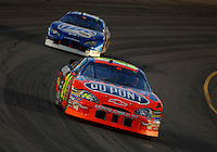Apr 22, 2006; Phoenix, AZ, USA; Nascar Nextel Cup driver Jeff Gordon of the (24) DuPont Chevrolet Monte Carlo leads Kurt Busch during the Subway Fresh 500 at Phoenix International Raceway. Mandatory Credit: Mark J. Rebilas-US PRESSWIRE Copyright © 2006 Mark J. Rebilas.
