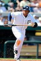 Detroit Tigers third baseman Miguel Cabrera #24 at bat during a Spring Training game against the Atlanta Braves at Joker Marchant Stadium on February 27, 2013 in Lakeland, Florida.  Atlanta defeated Detroit 5-3.  (Mike Janes/Four Seam Images)