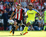 Billy Sharp of Sheffield Utd tackled by Tom Huddlestone of Derby County during the Championship match at Bramall Lane, Sheffield. Picture date 26th August 2017. Picture credit should read: Simon Bellis/Sportimage
