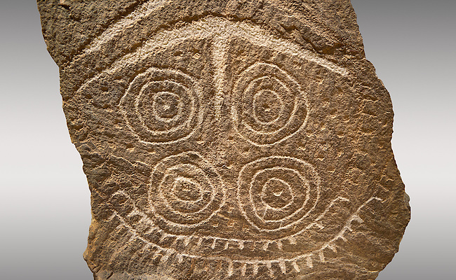 "Detail of Prehistoric  petroglyphs, rock carvings, with a geometric design carved by the the prehistoric Camuni people in the Copper Age around the 3rd milleneum BC, stele ""Cemmo 24"" from the prehistoric sanctuary Massi dei Cemmo Archaeological Site. Museo Nazionale della Preistoria della Valle Camonica ( National Museum of Prehistory in Valle Cominca ), Lombardy, Italy. Grey  Background"