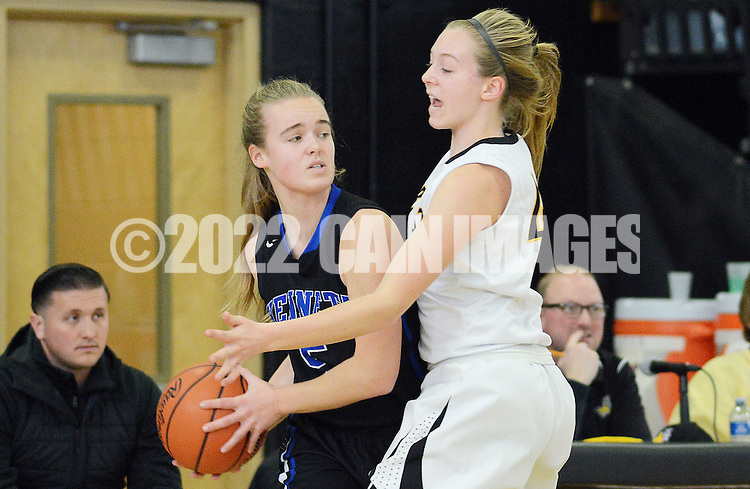 Kennett's Caroline Hertz #5 tries to pass the ball as Central Bucks West's Izzy Treon (right) #44 attempts to poke the ball away in the second quarter Saturday February 13, 2016 at Central Bucks West High School in Doylestown, Pennsylvania. Central Bucks West won 53-38. (Photo by William Thomas Cain)