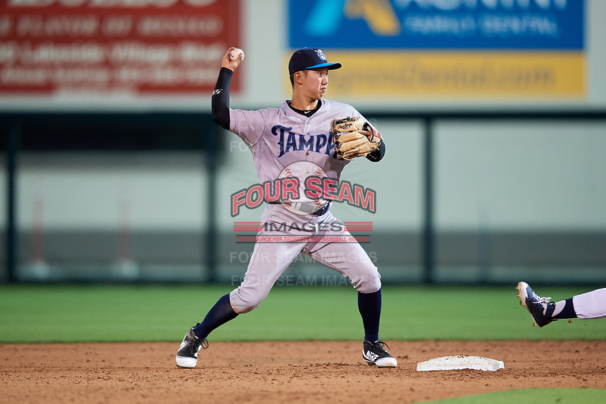 Tampa Tarpons second baseman Hoy Jun Park (1) throws to first base to try to complete a double play during a game against the Lakeland Flying Tigers on April 5, 2018 at Publix Field at Joker Marchant Stadium in Lakeland, Florida.  Tampa defeated Lakeland 4-2.  (Mike Janes/Four Seam Images)