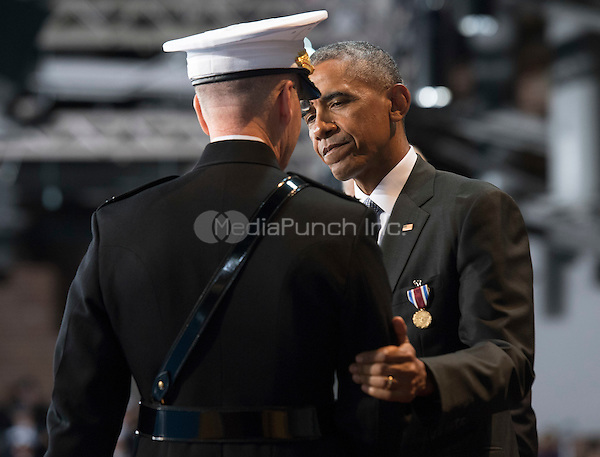 United States President Barack Obama shakes hands with Chairman of the Joint Chiefs of Staff Gen. Joseph Dunford Jr. during Obama's Armed Forces Full Honor Review Farewell Ceremony at Joint Base Myers-Henderson Hall, in Virginia on January 4, 2017. The five braces of the military honored the president and vice-president for their service as they conclude their final term in office. <br /> Credit: Kevin Dietsch / Pool via CNP /MediaPunch