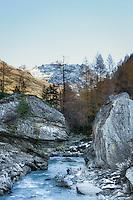 Austria, East-Tyrol, autumn scenery at Gschloess Valley near Matrei: mountain torrent Gschloessbach and High Tauern mountains   Oesterreich, Osttirol, Herbststimmung im Gschloesstal bei Matrei: der Gschloessbach bei Aussergschloess und Hohe Tauern