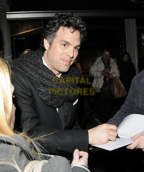 MARK RUFFALO .At the British Academy Film Awards (BAFTA) nominees party, Asprey, New Bond Street, London, England, UK, February 12th 2011..half length black scarf signing autographs .CAP/CAN.©Can Nguyen/Capital Pictures.