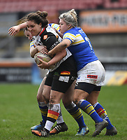 Picture by Anna Gowthorpe/SWpix.com - 15/04/2018 - Rugby League - Womens Super League - Bradford Bulls v Leeds Rhinos - Coral Windows Stadium, Bradford, England - Bradford Bulls' Debbie Smith is tackled by Leeds Rhinos' Aimee Staveley