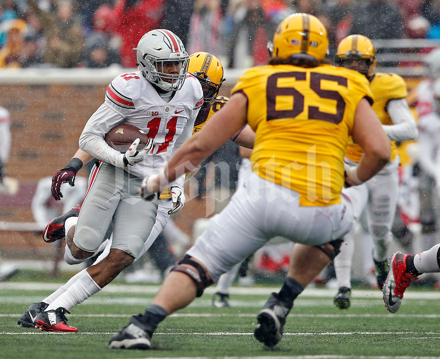 Ohio State Buckeyes defensive back Vonn Bell (11) returns an interception against Minnesota Golden Gophers during the 4th quarter at TCF Bank Stadium in Minneapolis, Minn. on November 15, 2014.  (Dispatch photo by Kyle Robertson)