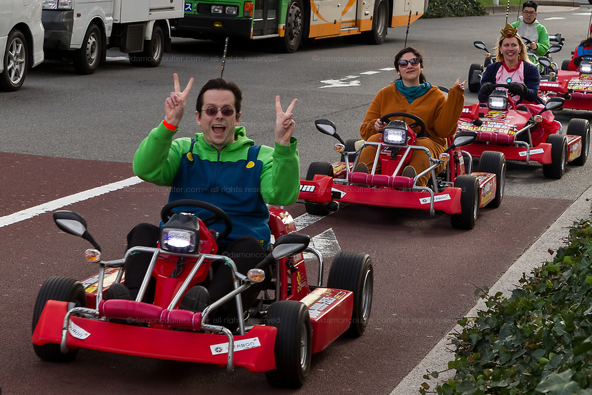 Tourists enjoy a go cart tour of Tokyo on Mari Carts, Odaiba, Tokyo, Japan. Friday March 24th 2017. The carts use the Super Mario carting characters from the video games though Nintendo who own the rights to the character has recently asked the company running the tours to stop using Mario cart characters.